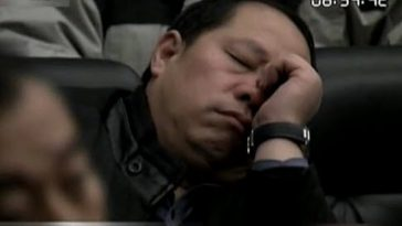 Government officials asleep during a government meeting.
