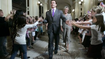 Unlike other Republicans, Schwarzenegger's political views were relatively moderate. In Democratic Party-dominated California, his affable celebrity image was widely popular. In 2004, Schwarzenegger's public support ratings reached 65%. Photo is of 2008 September 8th, in California's capital Sacramento, Schwarzenegger greets children while attending a ceremony.