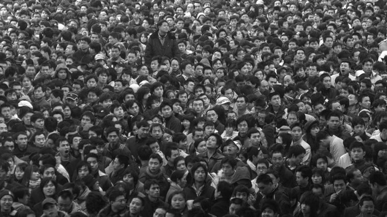 """Chun Yun"" has been called history's largest periodic human migration. Within a span of around 40 days, nearly 2 billion trips are made. Photo is of 2008 where passengers were delayed at the Guangzhou Railway Station due to snowstorms."
