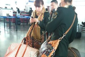chinese-female-soldiers-traveling-with-louis-vuitton-bags-preview
