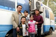 The Feng family in a family photo standing in front of their motor home in Henan.