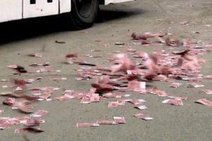 Beijing residents scramble for cash on the street.