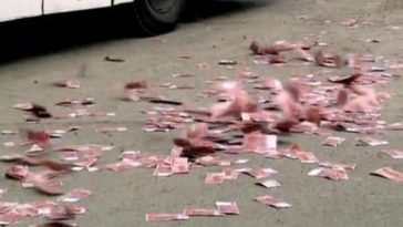 Beijing residents scramble for cash on the street.