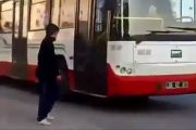 Teenager plays prank on a public bus, stopping the bus only to tie his shoelaces.