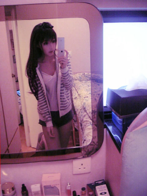 Wang Jiayun taking her own portrait in a mirror.