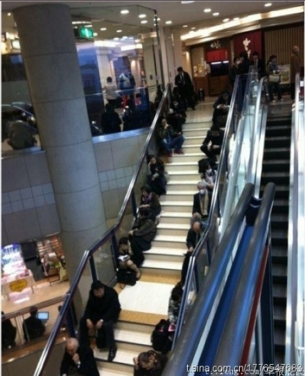 Japanese people sitting on the sides of the stairs, ensuring that the center remains clear and accessible. This is the result of education, not something that can be obtained through GDP [alone]