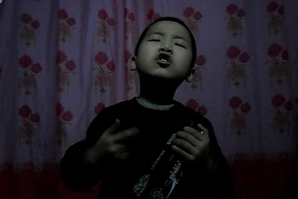 "A little Chinese boy sings a ""Chinese coal miner's child"" version of ""In Spring"""