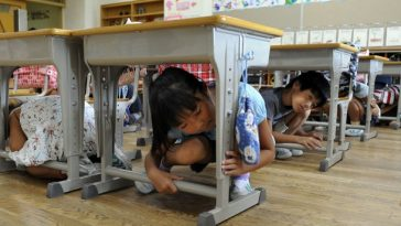 Elementary school children take cover under their desks as part of a nationwide earthquake drill at a Tokyo elementary school on September 1, 2010. People across Japan took part in the disaster drill to prepare for a major earthquake, on the anniversary of the massive 1923 earthquake which killed more than 140,000 people in the Tokyo area. AFP PHOTO / Yoshikazu TSUNO (Photo credit should read YOSHIKAZU TSUNO/AFP/Getty Images)