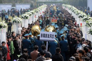 Crowds of people at the site of the memorial ceremony.