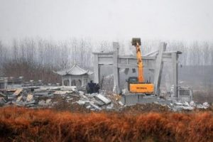 The local government demolishes an extravagant tomb built by a land dealer for his father in Wuhan, China.