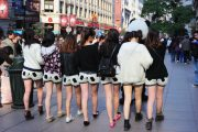 A group of Chinese girls wearing panda shorts on Nanjing Road in Shanghai.