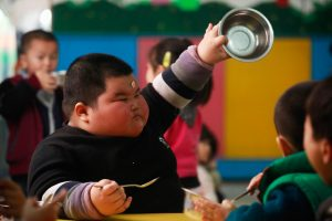 Xiao Hao at school after finishing eating.