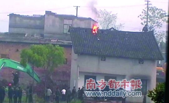 Chinese man protests forced eviction and demolition of home with self-immolation.