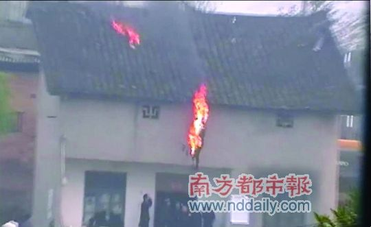 Man protesting forced demolition falls from roof after lighting self on fire.