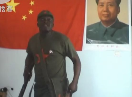 """An African man named """"Brother Hao"""" sings a Chinese Revolutionary-Era propaganda """"red"""" song to honor the Chinese Communist Party's upcoming 90th anniversary"""