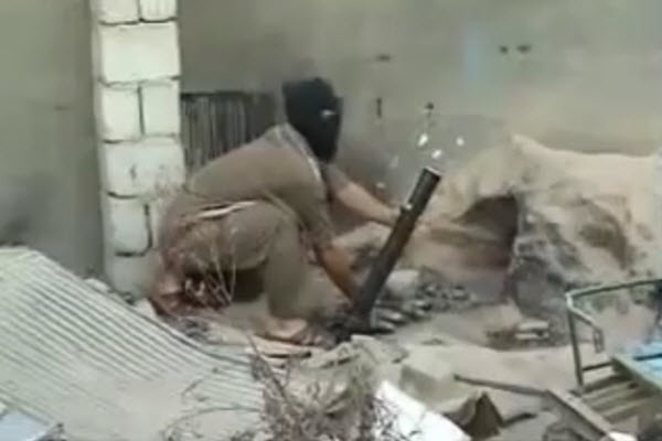 A Muslim terrorist/insurgent/freedom-fighter firing a mortar, moments before an explosion kills him.