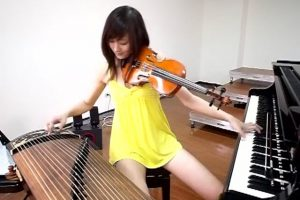 Shara Lin Yixin performs with the piano, violin, and zither.
