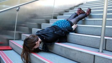 A Taiwanese girl lies face down, head first down a flight of steps in Taiwan.