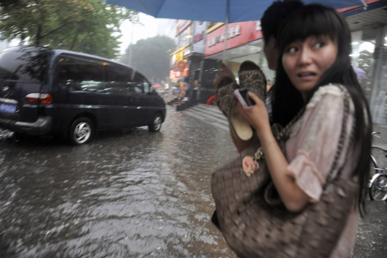 Beijing experiences heavy rains and severe flooding.