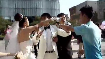 A Chinese bride demands her groom to explain who this other man is.