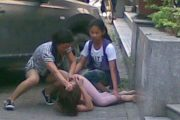 A Chinese wife attacks her cheating husband's mistress in Guangzhou, China.