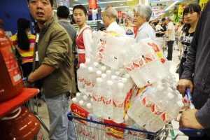 Hangzhou city residents panic-buying bottled water after a local river and water source is contaminated with phenol/carbolic acid.