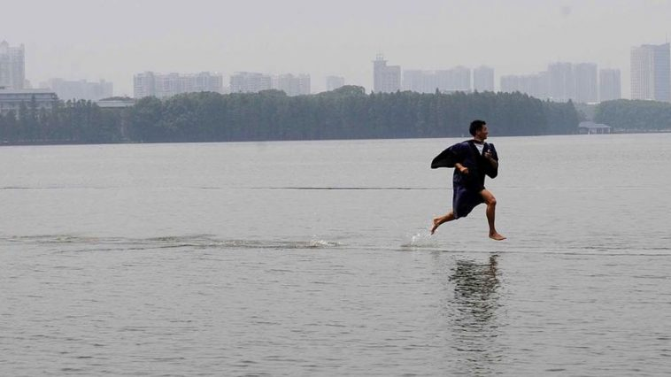 A Chinese university graduate runs on water following flooding in Wuhan, China.