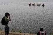 Wuhan university graduates take graduation photos on the water following flooding.