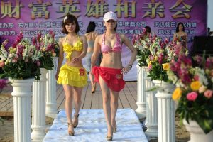 60 Chinese girls wearing bikinis vie for the attention of rich Chinese men who paid 99,999 RMB to partcipate in this matchmaking event.