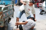 "A migrant worker in Zhejiang province of China beating his wife in public for ""not listening/obeying""."