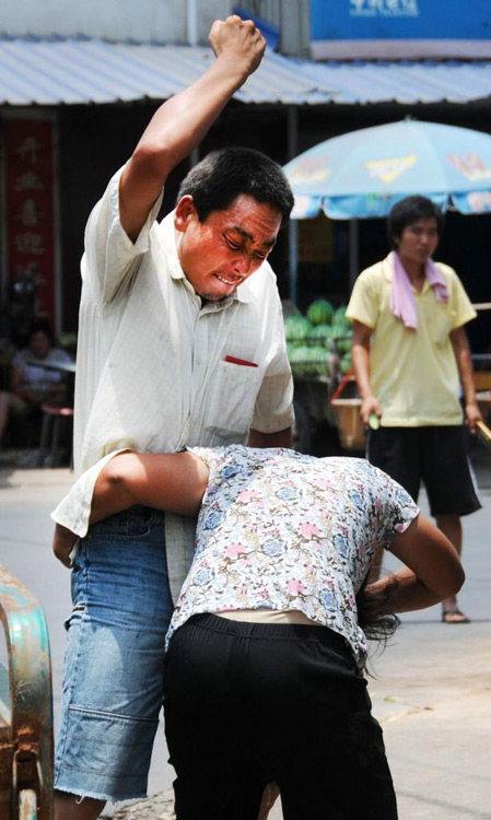 "A Chinese migrant worker beats on his wife in Zhejiang province of China, angry with her ""not listening/obeying""."