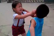 A little Chinese girl fights with her male cousin in Hubei, China captured on video by her father.