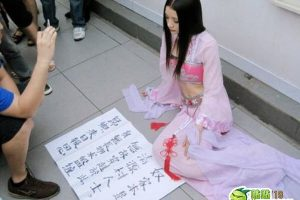 A woman dressed in traditional clothing claiming to have time-traveled from 500 years in the past begs for money in a Shanghai Metro stop to help her get back to her village 500 years ago.