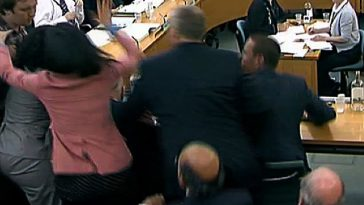 Murdoch's wife Wendi Deng jumping up to protect her husband and fight off the assailant.