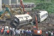 Excavators moving the wrecked traincars from the 2011 July 23 Wenzhou high speed train collision.