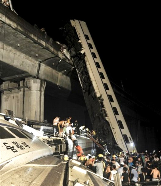 Local villages and rescue workers working throughout the night to rescue people from the Wenzhou high speed train accident.