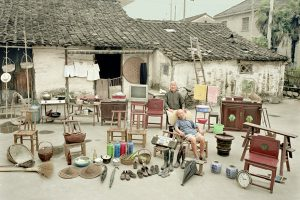 """Family Possessions"" by Huang Qingjun and Ma Hongjie, showing the furniture and household items of ordinary families in China."
