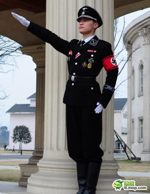 """Cosplay featuring a character dressed in a SS Nazi officer uniform and a character dressed as """"Chi"""" from the anime """"Chobits"""""""