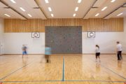 Basketball courts and a rock climbing wall in the gym inside Norway's Halden Prison.