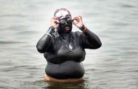 e38a790a1d3 Netizens dub a fat Chinese woman wearing a full-body swimsuit in Qingdao