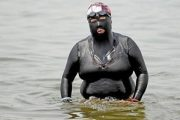 Swimsuit Auntie, a fat Chinese woman in Qingdao wearing a full-body swimsuit to avoid tanning.