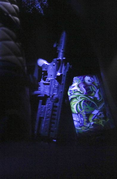 A toy machine gun on in the backseat of the BMW.