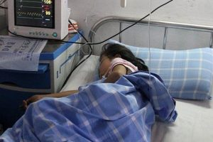 A small primary schoolgirl in China lies in the hospital with injuries after trying to commit suicide by jumping off a building over fears of not having finished her homework for school.