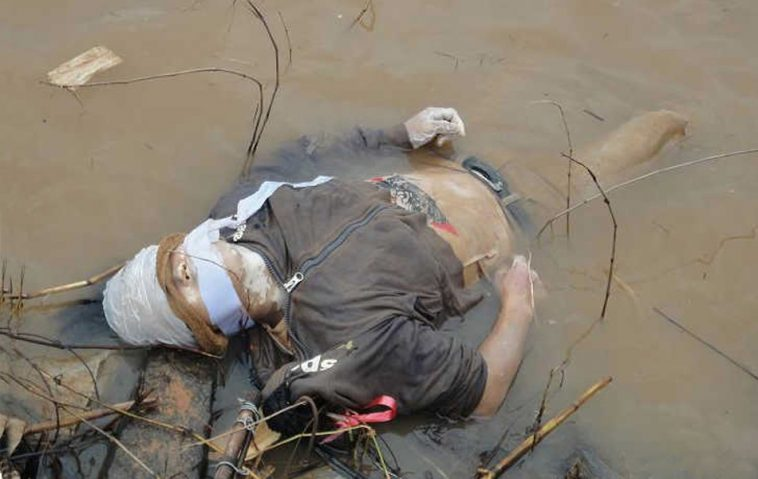 The body of a dead Chinese sailor recovered from the Mekong River after he was killed by Golden Triangle drug smugglers.