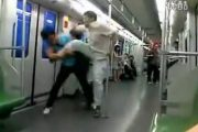Two Shanghainese men fighting on the Shanghai Metro, one kicking the other.