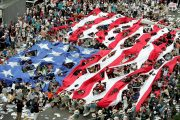 South Korean protesters tear apart a large American flag demanding that American troops stationed in South Korea be withdrawn.