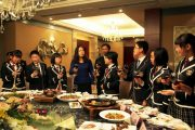 Chinese students at a dinner hosted by the school principal in recognition of their academic achievements.