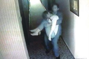 Administry of Work Safety Deputy Director Zhang Sen carrying an unconcious female cadre to a hotel room.