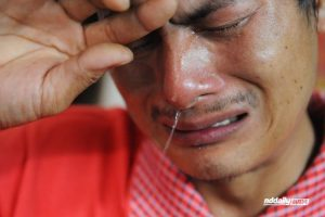 Yang Wu, a husband who hid while his wife was beaten and raped cries.