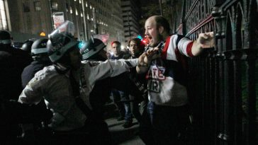 A physical confrontation between Occupy Wall Street protesters and New York City police forces.
